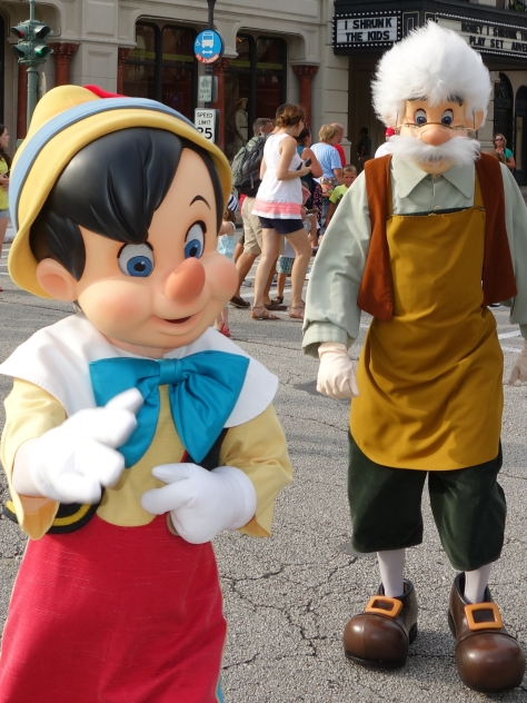Pinocchio and Gepetto getting ready to meet some guests.