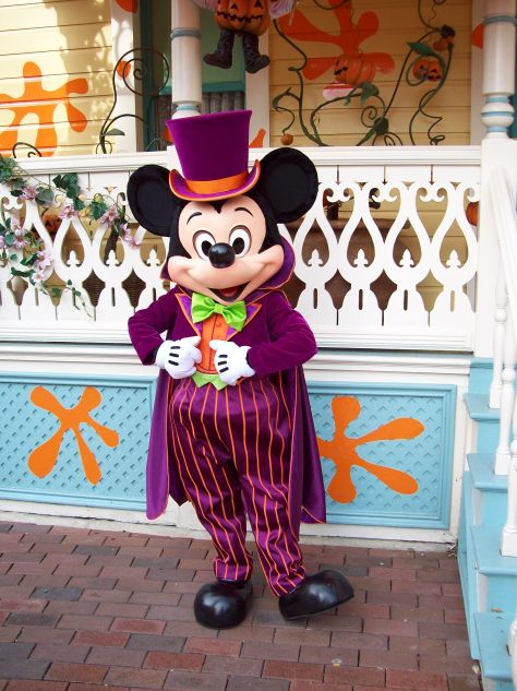 In 2008 Mickey was showing his Halloween side by wearing this purple Halloween outfit. Mickey couldn't decide if he wanted to wear his top hat with it or not, in this photo he decided to wear it.